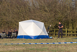 "© Licensed to London News Pictures. 23/02/2019. Highworth, Wiltshire, UK. Police search a field off Pentylands Lane in Highworth. It is reported that police are probing a potential link to the disappearance of Linda Razzell, a mother of four missing since 2002. Linda Razzell was last seen on her way to work in Swindon but the 41-year-old's body has never been found. Her husband, Glyn, was sentenced to life for her murder in 2003. Wiltshire Police said it was acting on a tip-off from the public and it was ""keeping an open mind"" as to whether it relates to Mrs Razzell's murder. Photo credit: Simon Chapman/LNP"