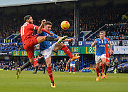 Portsmouth defender Enda Stevens beats Leyton Orient Midfielder Jobi McAnuff to the ball in the penalty area during the Sky Bet League 2 match between Portsmouth and Leyton Orient at Fratton Park, Portsmouth, England on 6 February 2016. Photo by Adam Rivers.