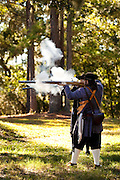 Costumed re-enactors fire 17th century muskets along the fortifications of historic Charles Towne Landing, the original settlement of Charleston, SC where English settlers established the city in 1670. The site is now a state park and historic site.