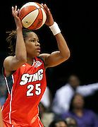 Charlotte Sting forward Monique Currie looks to pass during this WNBA game between the Mystics and the Sting at the Verizon Center in Washington, DC. The Mystics won 87-70.  June 13, 2006  (Photo by Mark W. Sutton)