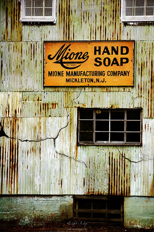 A Mione Manufacturing Company building displaying a vintage hand soap sign. The image lent itself to some texturing effects which have been added.