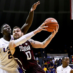Jan 23, 2013; Baton Rouge, LA, USA; LSU Tigers forward Johnny O'Bryant III (2) defends against Texas A&M Aggies forward Andrew Young (0) during the first half of a game at the Pete Maravich Assembly Center. Mandatory Credit: Derick E. Hingle-USA TODAY Sports