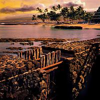 A coastal Hawaiian golf course sits in the distance