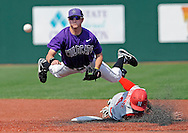 Kansas State University -- Base runner D.J. Belfonte #4 of the Nebraska Cornhuskers brakes up a double play as he takes out second basemen Jake Brown #6 of the Kansas State Wildcats in the third inning at Tointon Stadium in Manhattan, Kansas.  Kansas State won 13-5.  ..