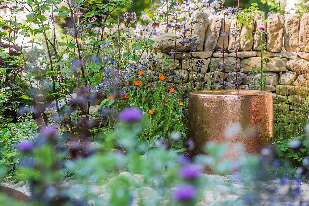 The Warner Edwards Garden, Sponsor: Warner Edwards, Designer: Kate Savill & Tamara Bridge and Contractor: Frogheath Landscapes - The RHS Chelsea Flower Show at the Royal Hospital, Chelsea.
