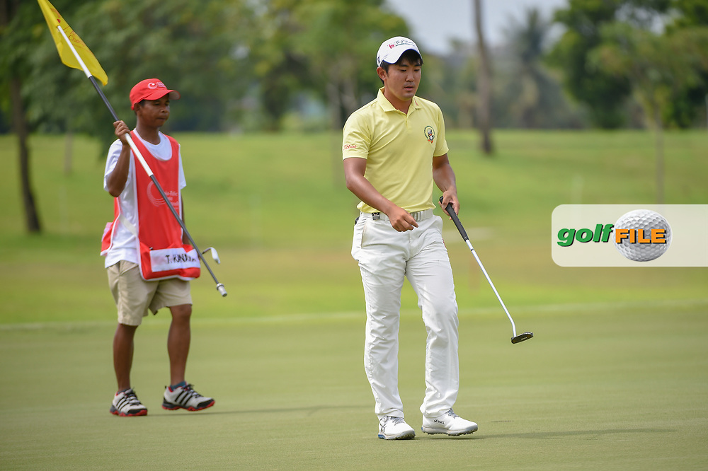 Takumi KANAYA (JPN) departs the green on 7 after sinking his par saving putt during Rd 4 of the Asia-Pacific Amateur Championship, Sentosa Golf Club, Singapore. 10/7/2018.<br /> Picture: Golffile   Ken Murray<br /> <br /> <br /> All photo usage must carry mandatory copyright credit (© Golffile   Ken Murray)