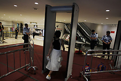 June 29, 2017 - Hong Kong, CHINA - Citizens must go through metal detector before entering  buildings adjacent to CONVENTION CENTRE where Chinese President Xi Jin Ping will officiate new HKSAR administration during his 3 days visit. Hong Kong will be celebrating 20th anniversary of territorys HANDOVER to China tomorrow on 30th of June. June 29, 2017.Hong Kong.ZUMA/Liau Chung Ren (Credit Image: © Liau Chung Ren via ZUMA Wire)
