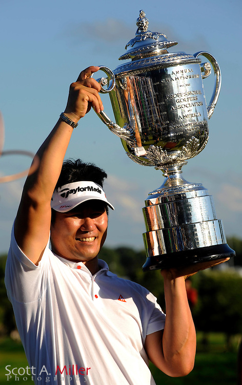 Aug 16, 2009; Chaska, MN, USA; Y.E. Yang (KOR) hoists the Wanamaker Trophy after winning the 2009 PGA Championship at Hazeltine National Golf Club.  ©2009 Scott A. Miller