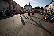 Thaxted Morris Weekend 3-4 June 2017<br /> A meeting of member clubs of the Morris Ring celebrating the 90th anniversary of the founding of the Thaxted Morris Dancing side or team in Thaxted, North West Essex, England UK. <br /> Claro side perfom in Town Street Thaxted Essex during the early evening mass dancing through the town.<br /> Hundred of Morris dancers from the UK and this year the Silkeborg side from Denmark spend most of Saturday dance outside pubs in nearby villages where much beer is consumed. In the late afternoon all the sides congregate in Thaxted where massed dancing is perfomed along Town Street. As darkness falls across Thaxted the spell binding Abbots Bromley Horn Dance is performed to the sound of a solo violin in the dark.