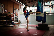 BANGKOK, THAILAND, 2012:.Chantal training hard. August 2012.From the East Village of Manhattan to Bangkok, a career in the underground cinema to the Thai boxing ring. It 's the story of  Chantal Ughi, angel face with a background in fashion and now world champion muay thai, sport who struck by when she saw for the first time a fight in a gym in New York. After seven years in the Big Apple with different experiences in the musical, artistic , fashion, movie, Chantal dropped everything to attend a course of martial arts that had haunted. She suppose to stay in Bangkok four weeks. Four years later, at the price of enormous sacrifices and strict self-discipline, she can say that her dream has come true.  © Giulio Di Sturco..