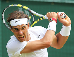 Image ©Licensed to i-Images Picture Agency. 26/06/2014. London, United Kingdom. Rafael Nadal in action on Centre Court  during his second round win on day four of the Wimbledon Tennis Championships. Picture by Stephen Lock / i-Images