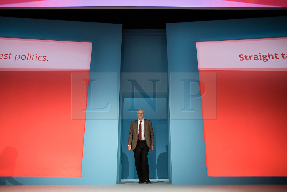 © Licensed to London News Pictures . 29/09/2015 . Brighton , UK . JEREMY CORBYN enters the stage to deliver his speech to the 2015 Labour Party Conference . Photo credit : Joel Goodman/LNP