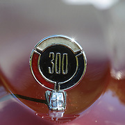 The emblem of a 1966 Chrysler 300 at the Greenwich Concours d'Elegance Festival of Speed and Style featuring great classic vintage cars. Roger Sherman Baldwin Park, Greenwich, Connecticut, USA.  2nd June 2012. Photo Tim Clayton