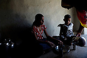 Pooja, 14, a student from the village of Pathpuri, Hoshangabad, Madhya Pradesh, India, taking part to the children's journal, a project launched by Dalit Sangh, an NGO which has been working for the uplift of scheduled castes for the past 22 years, is eating with her younger brother Narendra Kumar, 9, in their home. Dalit Sangh is working in collaboration with Unicef India to promote education and awareness within backward communities.
