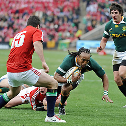 Odwa Ndungane of the Springboks tackled by Matthew Rees of the British and Irish Lions during the British and Irish Lions tour 2009