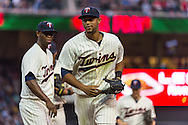 Aaron Hicks #32 of the Minnesota Twins is congratulated by Samuel Deduno #21 after he made a diving catch during a game against the Milwaukee Brewers on May 29, 2013 at Target Field in Minneapolis, Minnesota.  The Twins defeated the Brewers 4 to 1.  Photo: Ben Krause