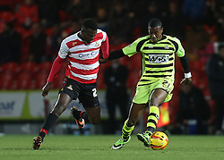 Yeovil Town's Liam Davis battles with Doncaster Rovers' Theo Robinson- Photo mandatory by-line: Matt Bunn/JMP - Tel: Mobile: 07966 386802 22/11/2013 - SPORT - Football - Doncaster - Keepmoat Stadium - Doncaster Rovers v Yeovil Town - Sky Bet Championship