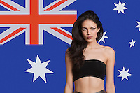 Portrait of young woman in tube bra against Australian flag
