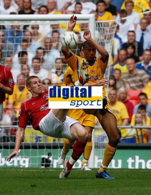 Photo: Steve Bond/Richard Lane Photography. <br /> Ebbsfleet United v Torquay United. The FA Carlsberg Trophy Final. 10/05/2008. Chris Zebroski (R) tries to block Neil Barrett's clearance (L)