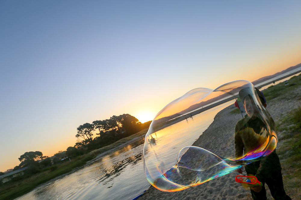 kuaotunu bubbles festival 2016 at the kuaotunu reserve coromandel photographer felicity jean photography kuaotunu photos Bubbles Festival in Kuaotunu at the reserve . Adults  drink bubbles children blow bubbles. Coromandel Photographer Felicity Jean Photography
