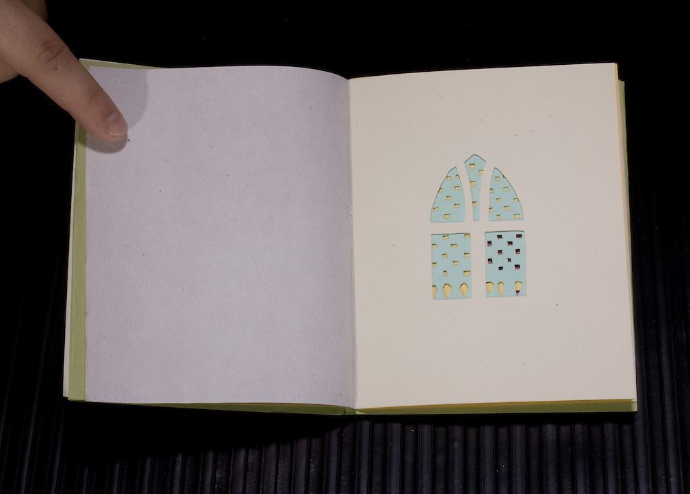 Artist: Allison Welch. Title: Double Alternative. Pamphlet style binding with cut outs for imagery.