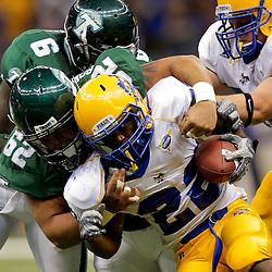 Sep 26, 2009; New Orleans, LA, USA;  McNesse State Cowboys running back Todd Pendland (22) is tackled by Tulane Green Wave defensive tackle Oscar Ponce de Leon (62) at the Louisiana Superdome. Tulane defeated McNeese State 42-32. Mandatory Credit: Derick E. Hingle-US PRESSWIRE