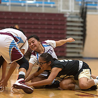 Ganado Hornets Jailyan Curley (10) and Amber James (20) and Chinle Wildcat Shania Yazzie (30) struggle to gain possession of the ball during the game in Ganado Tuesday.