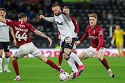 Derby County forward Wayne Rooney and Northampton Town midfielder Paul Anderson challenge for the ball during the The FA Cup match between Derby County and Northampton Town at the Pride Park, Derby, England on 4 February 2020.