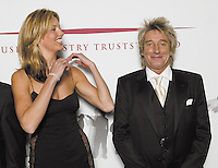 Rob Dickins CBE receives the Music Industry Trust&rsquo;s Award at the Grosvenor Hotel London.<br /> Presented to him by Rod Stewart.