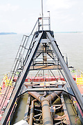 {8/24/12} {10pmCST} -JOB # 42286- Greenville , MS, U.S.A. --Workers on The Dredge JADWIN, of the US Army Corp of Engineers, begin dredging a stretch of the Mississippi River 7 miles downriver from Greenville MS. where the Army Corp of Engeineers is dredging the river to keep it open to tug boat traffic. Pictured workers connect the JADWIN to a 1000 foot pipeline to carry out the sludge.  Sandbars creep up as the water level drops on the Mississippi River makeing navigating the Mississippi River difficult for tug boat captains Ron Mook , Friday August 24,2012. Historically low river levels on the Mississippi River are causing havoc on river traffic: grounding barges loaded with grain and fertilizer, traffic jams several miles long and forcing the Coast Guard to close down chunks of the river due to groundings. The area around Greenville, Miss., has closed three times the past week due to groundings. Last year, there were five total groundings the entire low-water season. Locals who fought historic high-water floods last year are this year engaged in a different fight: keeping barges afloat on a vanishing Mississippi.  -- Photo by Suzi Altman, Freelance.