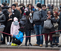 © Licensed to London News Pictures. 09/03/2020. London, UK. A A family wearing medical masks outside Buckingham Palace in central London. New cases of the COVID-19 strain of Coronavirus are being reported daily as the government outlines it's plans for controlling the outbreak. Photo credit: Ben Cawthra/LNP