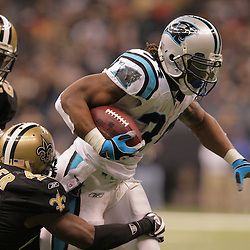 2008 December, 28: Carolina Panthers running back DeAngelo Williams (34) breaks the tackle of New Orleans Saints safety Roman Harper (41) during a week 17 game between NFC South divisional rivals the Carolina Panthers and the New Orleans Saints at the Louisiana Superdome in New Orleans, LA.