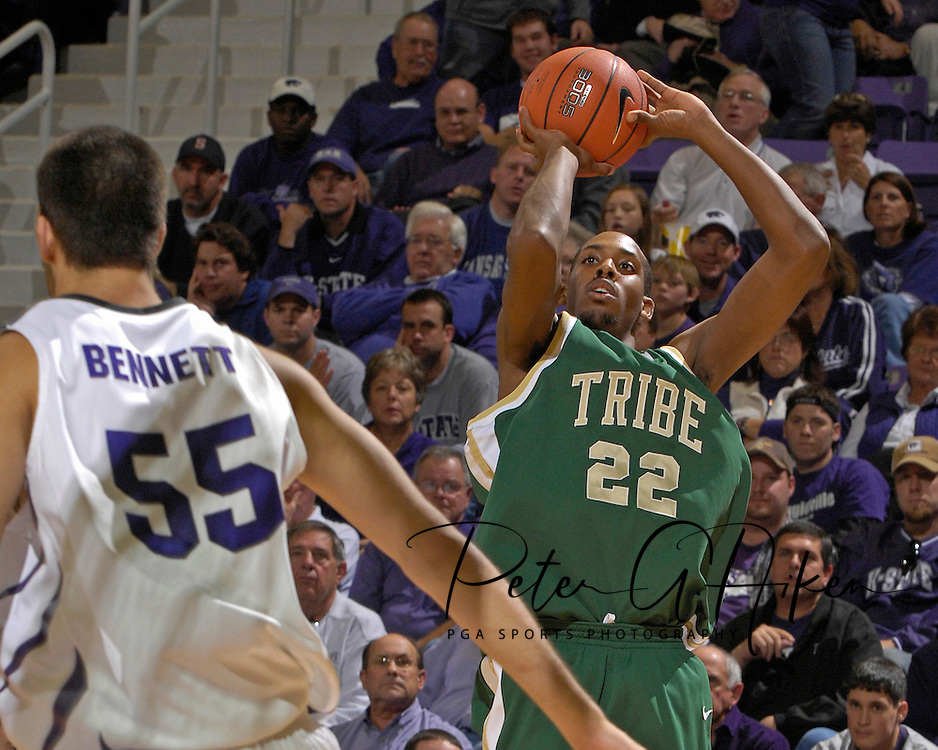 William &amp; Mary forward Danny Sumner (22) puts up a shot over Kansas State center Jaosn Bennett (55) in the first half at Bramlage Coliseum in Manhattan, Kansas, November 11, 2006.  K-State defeated the Tribe 70-60.<br />