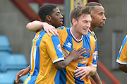 Sullay Kaikai of Shrewsbury Town celebrates scoring with Matt Tootle of Shrewsbury Town to go 1-0 upduring the Sky Bet League 1 match between Scunthorpe United and Shrewsbury Town at Glanford Park, Scunthorpe, England on 17 October 2015. Photo by Ian Lyall.