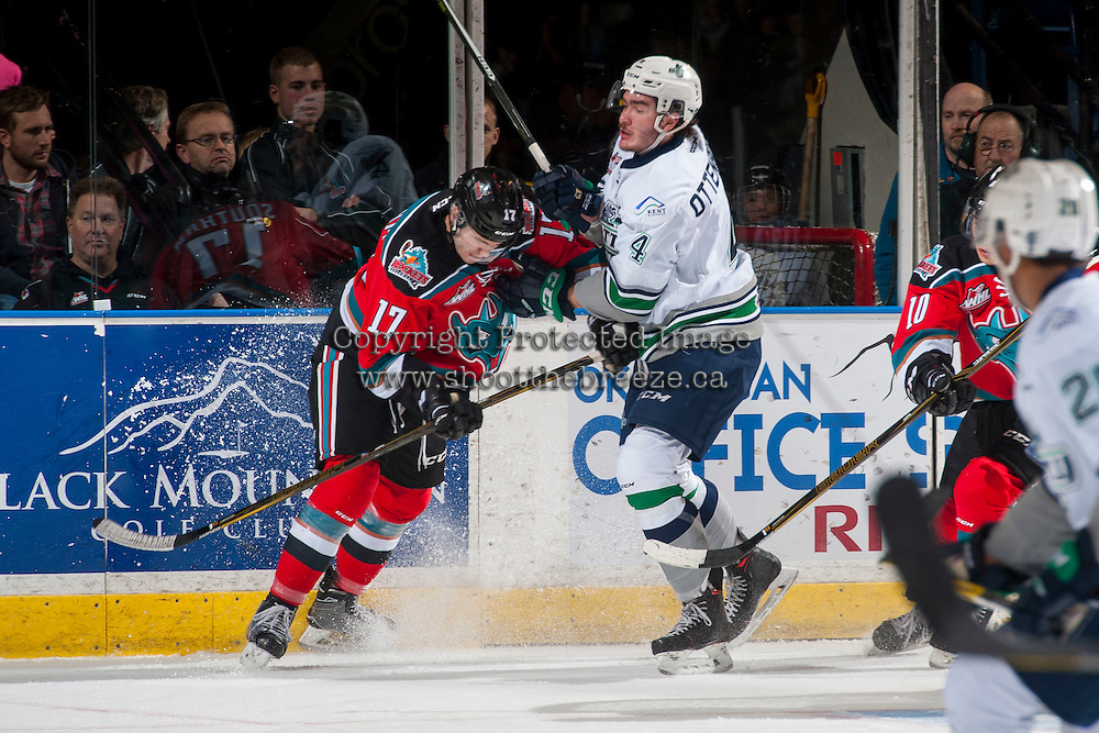 KELOWNA, CANADA - DECEMBER 7: Rodney Southam #17 of the Kelowna Rockets checks Turner Ottenbreit #4 of the Seattle Thunderbirds on December 7, 2016 at Prospera Place in Kelowna, British Columbia, Canada.  (Photo by Marissa Baecker/Shoot the Breeze)  *** Local Caption ***