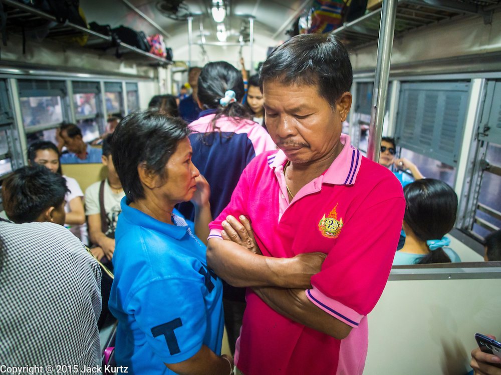 11 APRIL 2015 - BANGKOK, THAILAND: People stand on a crowded 3rd class train going to Aranyaprathet, on the Thai-Cambodian border. More than 130,000 passengers streamed through Bangkok's main train station Friday ahead of Songkran, Thailand's traditional new year celebration. Songkran will be celebrated April 13-15 but people started streaming out of Bangkok on April 10 to go back to their home provinces.    PHOTO BY JACK KURTZ