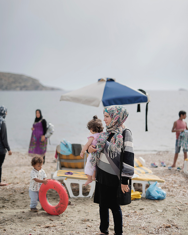 Najah from Syria, with her 11 month old daughter Amenah, at Gourna Beach. It is the first time they have been back to the sea since they were rescued by the coast guard after crossing from Turkey.
