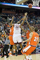 Virginia Tech Hokies guard Jamon Gordon (22) shoots over Illinois Fighting Illini guard Rich McBride (33).  The #5 seed Virginia Tech Hokies defeated the #12 seed Illinois Illini 54-52 in the first round of the Men's NCAA Tournament in Columbus, OH on March 16, 2007.