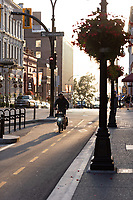 Fort Street in downtown Victoria BC features colorful flower baskets along the pedestrian and bike-friendly streets.