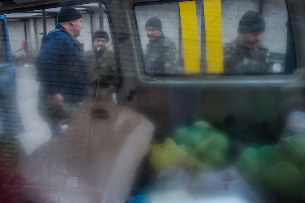 PISKY, UKRAINE - NOVEMBER 17, 2014: Members of the Ukrainian army receive a delivery of food and medical supplies at the abandoned building being used as their base in the fight against pro-Russia rebels for control of the Donetsk airport, in Pisky, Ukraine. CREDIT: Brendan Hoffman for The New York Times