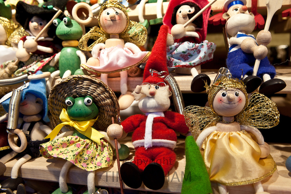 Ornaments of Father Christmas and other characters at Christmas market, Winter Wonderland, in Hyde Park, London