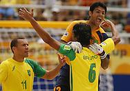 Football-FIFA Beach Soccer World Cup 2006 - Group A- Brazil - Japan, Beachsoccer World Cup 2006. Brasilian's Bruno, Mao and Buru - Rio de Janeiro - Brazil 05/11/2006. Mandatory credit: FIFA/ Manuel Queimadelos