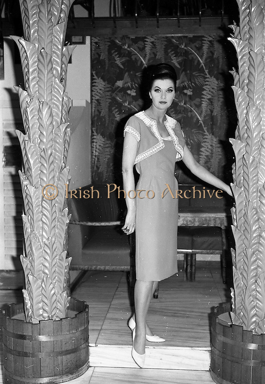 """12/02/1963<br /> 02/12/1963<br /> 12 February 1963<br /> Irene Gilbert Fashion show at the Gresham Hotel, Dublin. Picture shows """"Rustproof"""", coral crepe evening dress and bolero."""