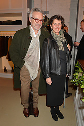 STEPHEN BAYLEY and his wife FLO at the launch of the Private White VC flagship store, 73 Duke Street, London on 11th December 2014.