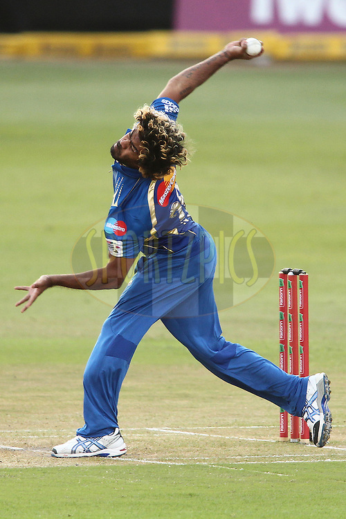 Lasith Malinga of the Mumbai Indians sends down a delivery during match 18 of the Karbonn Smart CLT20 South Africa between The Sydney Sixers and The Mumbai Indians held at Kingsmead Park in Durban, South Africa on the 22nd October 2012..Photo by Shaun Roy/SPORTZPICS/CLT20