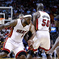 12 March 2011:  Miami Heat small forward LeBron James (6) drives past Memphis Grizzlies small forward Shane Battier (31) on a screen set by Miami Heat center Joel Anthony (50) during the Miami Heat 118-85 victory over the Memphis Grizzlies at the AmericanAirlines Arena, Miami, Florida, USA. **
