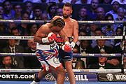 David Haye throws a punch at Tony Bellew and he is backed off on the ropes at the O2 Arena, London, United Kingdom on 5 May 2018. Picture by Phil Duncan.