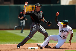 OAKLAND, CA - MAY 27:  Nick Ahmed #13 of the Arizona Diamondbacks is unable to complete a double play after forcing out Marcus Semien #10 of the Oakland Athletics at second base during the first inning at the Oakland Coliseum on May 27, 2018 in Oakland, California. The Oakland Athletics defeated the Arizona Diamondbacks 2-1. (Photo by Jason O. Watson/Getty Images) *** Local Caption *** Nick Ahmed; Marcus Semien