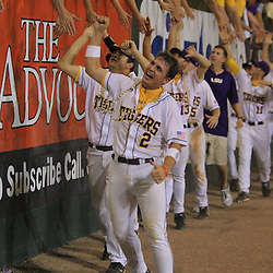 09 June 2008:  LSU reserve Buddy Haydel screams with excitement as he greets fans along with teammates along the left field fence following Tigers 21-7 victory over the UC Irvine Anteaters in game three of the NCAA Baseball Baton Rouge Super Regional Alex Box Stadium in Baton Rouge, LA.  LSU with the win over UC Irvine advances to the College Baseball World Series in Omaha, Nebraska.