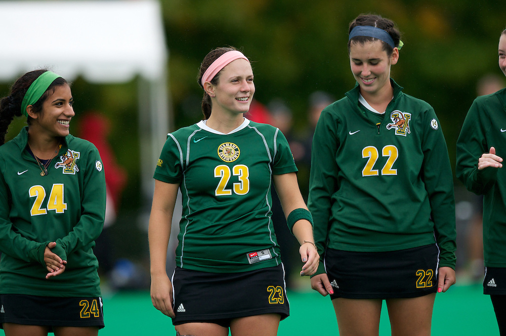 Catamounts defenseman Jenna Todero (24), Catamounts midfielder Angie DeBellis (23) and Catamounts midfielder Maddy Ostrander (22) during player introductions before the start of the women's field hockey game between the Maine Black Bears and the Vermont Catamounts at Moulton/Winder Field on Saturday afternoon September 29, 2012 in Burlington, Vermont.